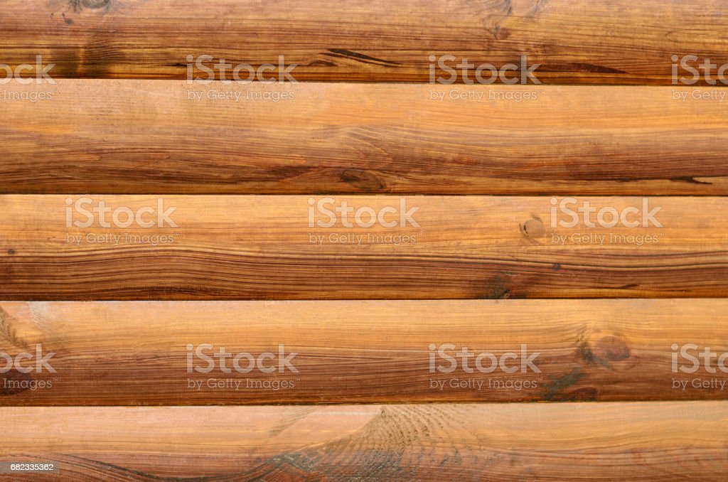 background from boards of solid wood, brown color stock photo