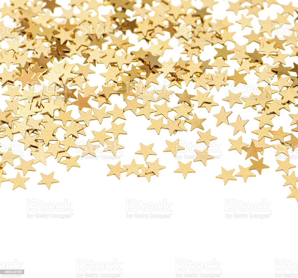 background from golden confetti in star shape stock photo