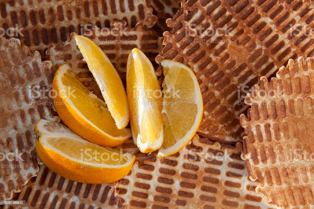 Background from home wafers and slices of orange stock photo