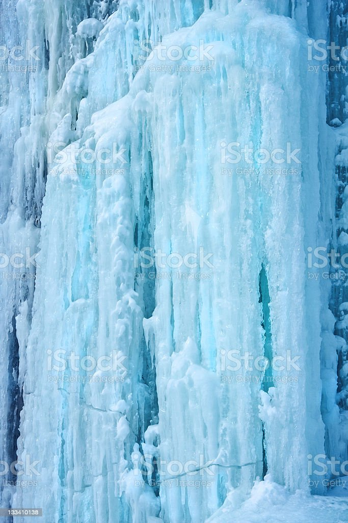 Background from ice and icicles of blue colour stock photo