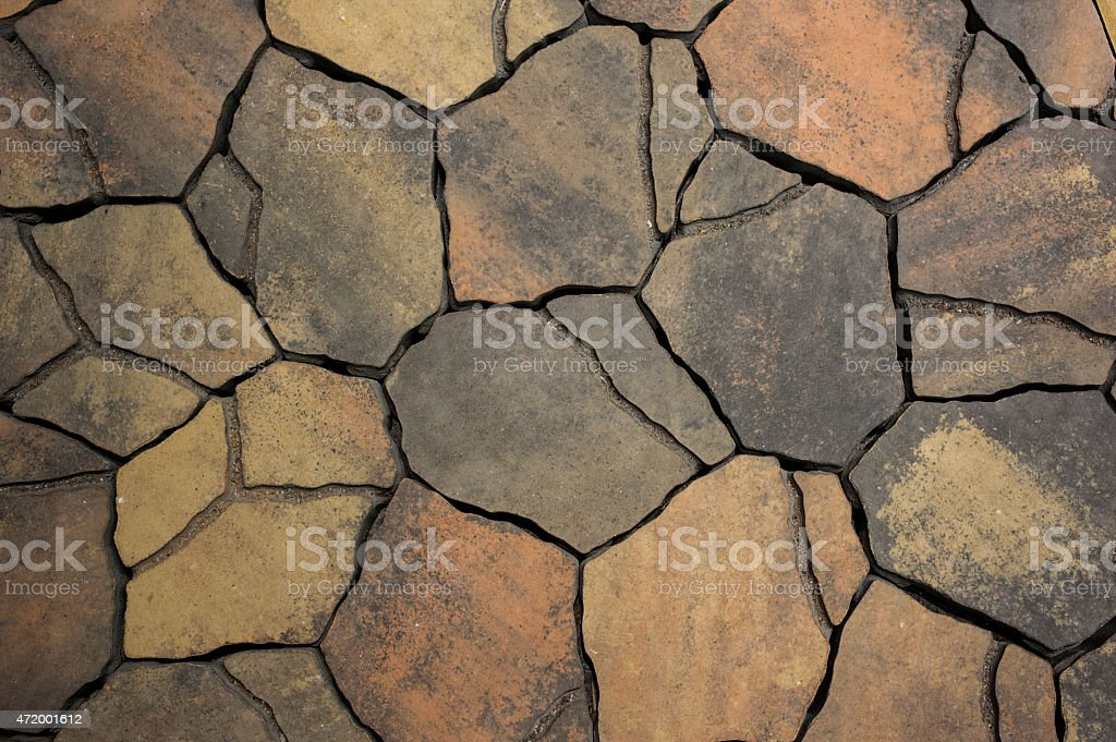 Background from paving stones, irregular natural stones stock photo