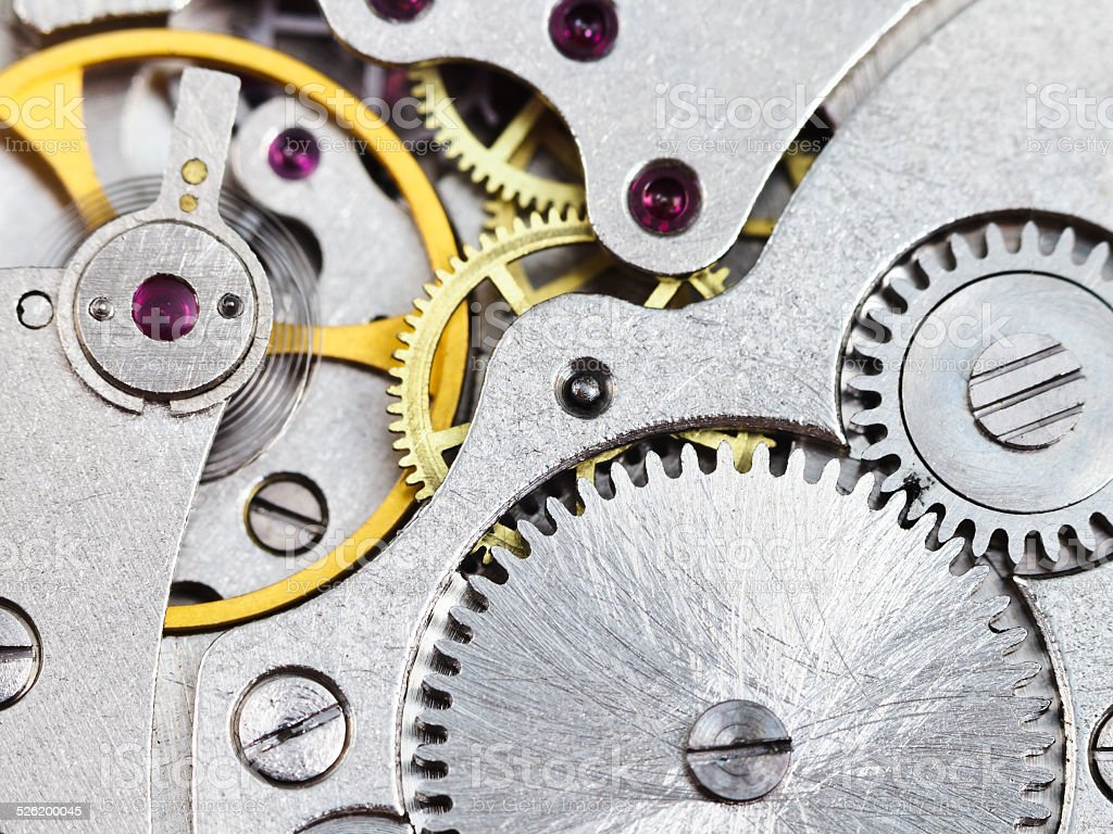 background from steel clockwork of vintage watch stock photo