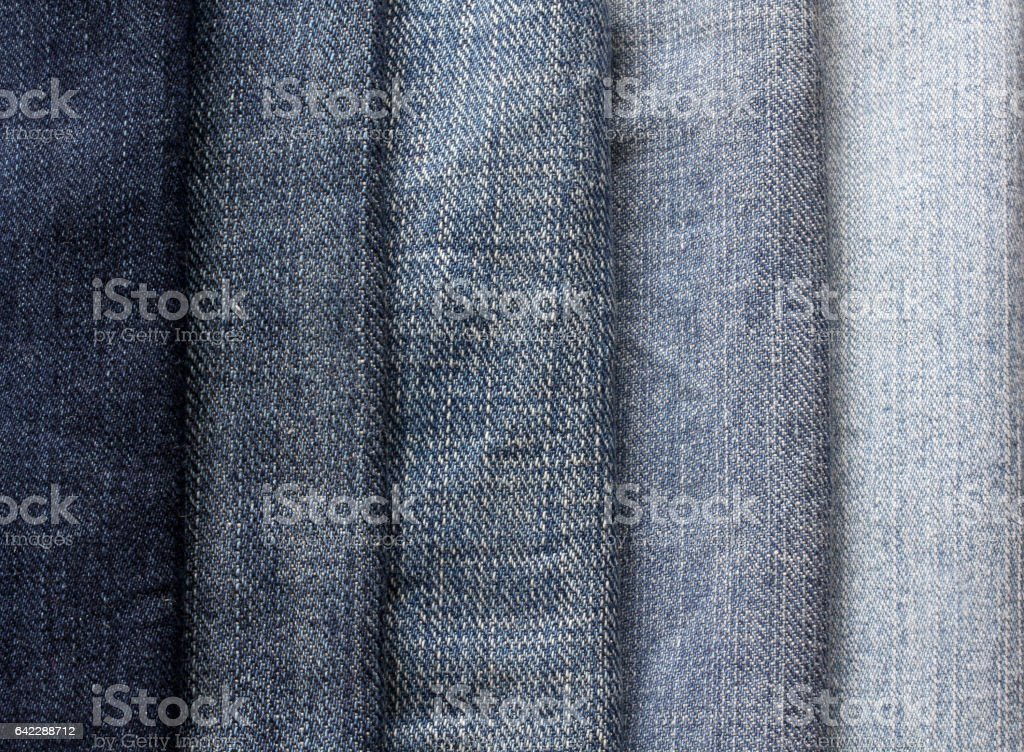 background from strips of blue jeans of different shades and brightness stock photo