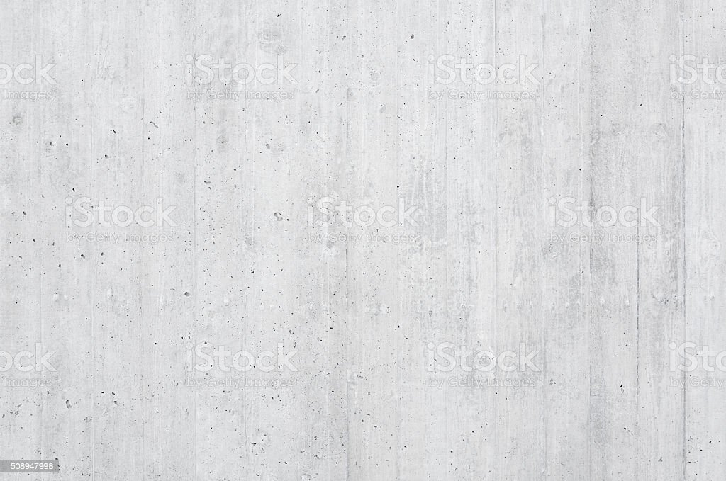 Close-up of a high-quality board formed concrete wall with vertical...