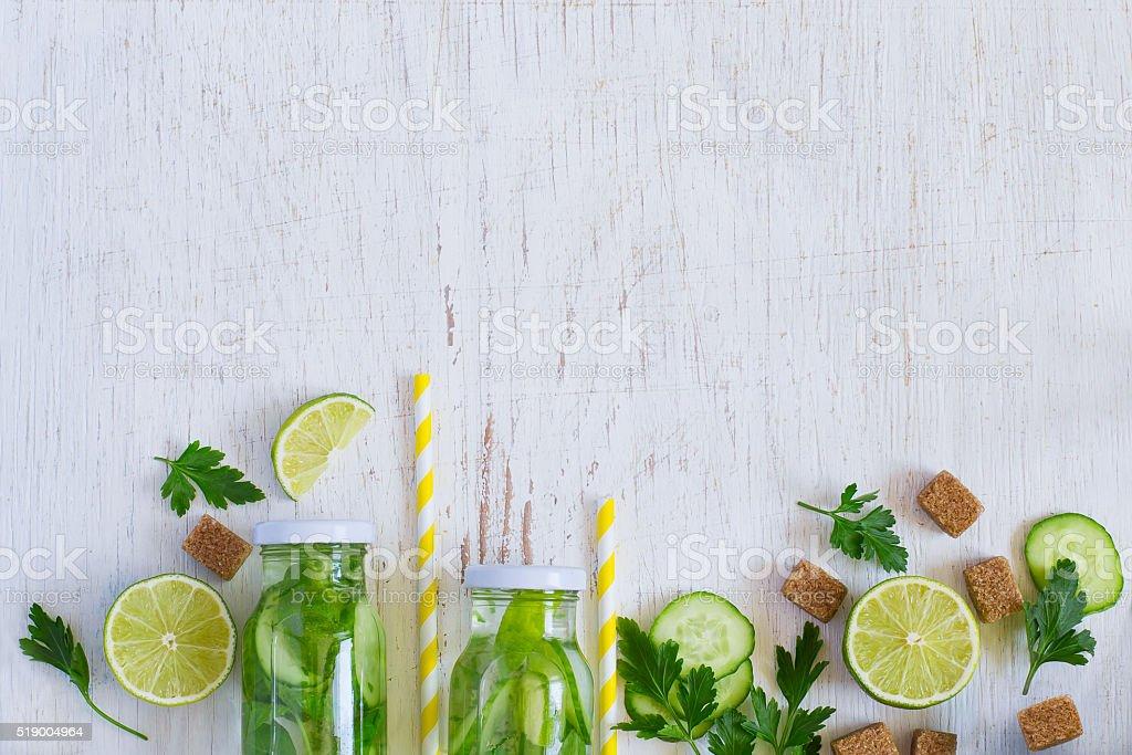 Background homemade lemonade bottles, cucumber, lime stock photo