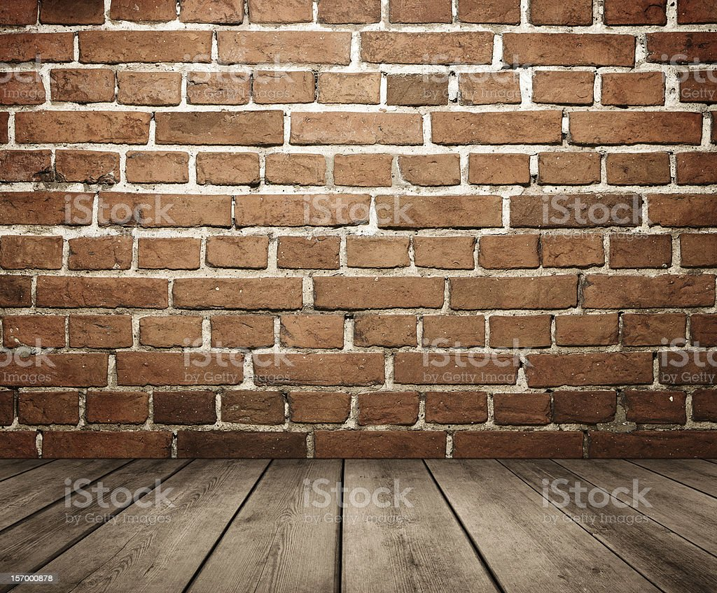 Background image of a grunge brick wall and wood floor stock photo