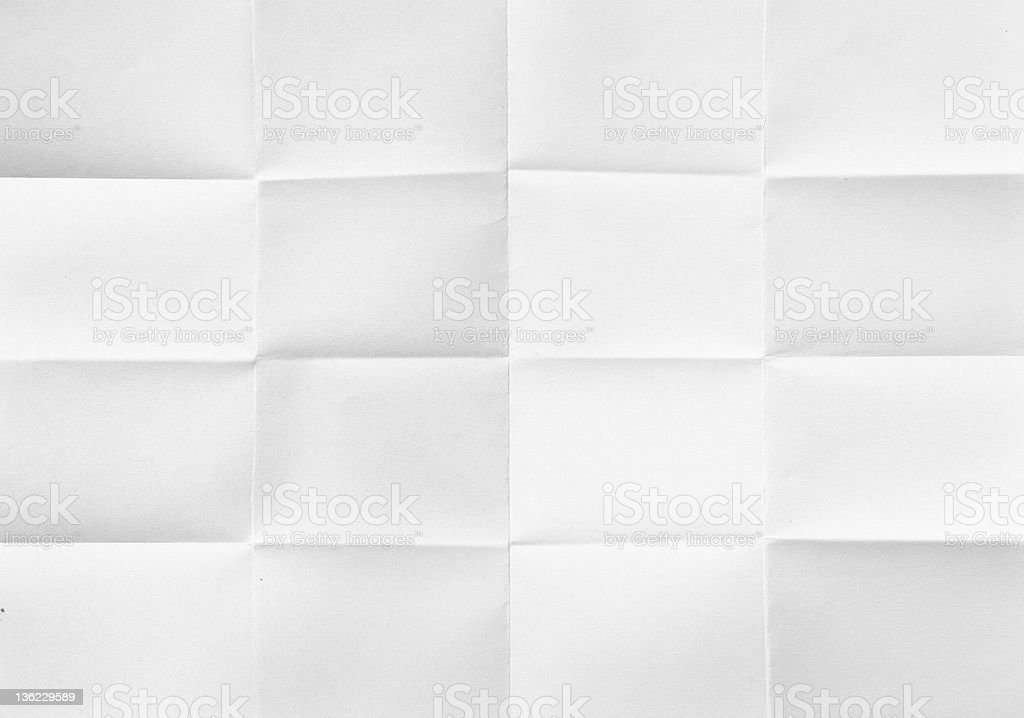 Background image of a white folded sheet of paper stock photo