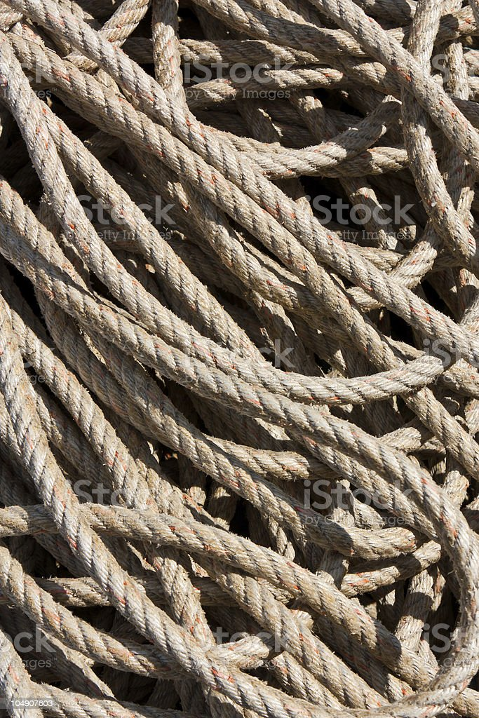 Background image of coiled, used rope royalty-free stock photo