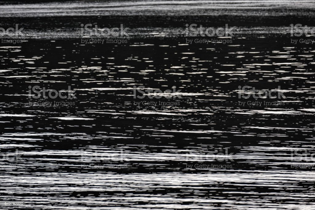 Background image of water ripples on a river stock photo