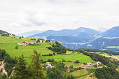 background landscape small Alpine village in Italy