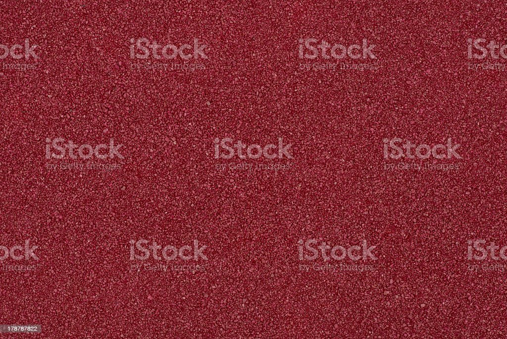 Background made of red decorative sand stock photo