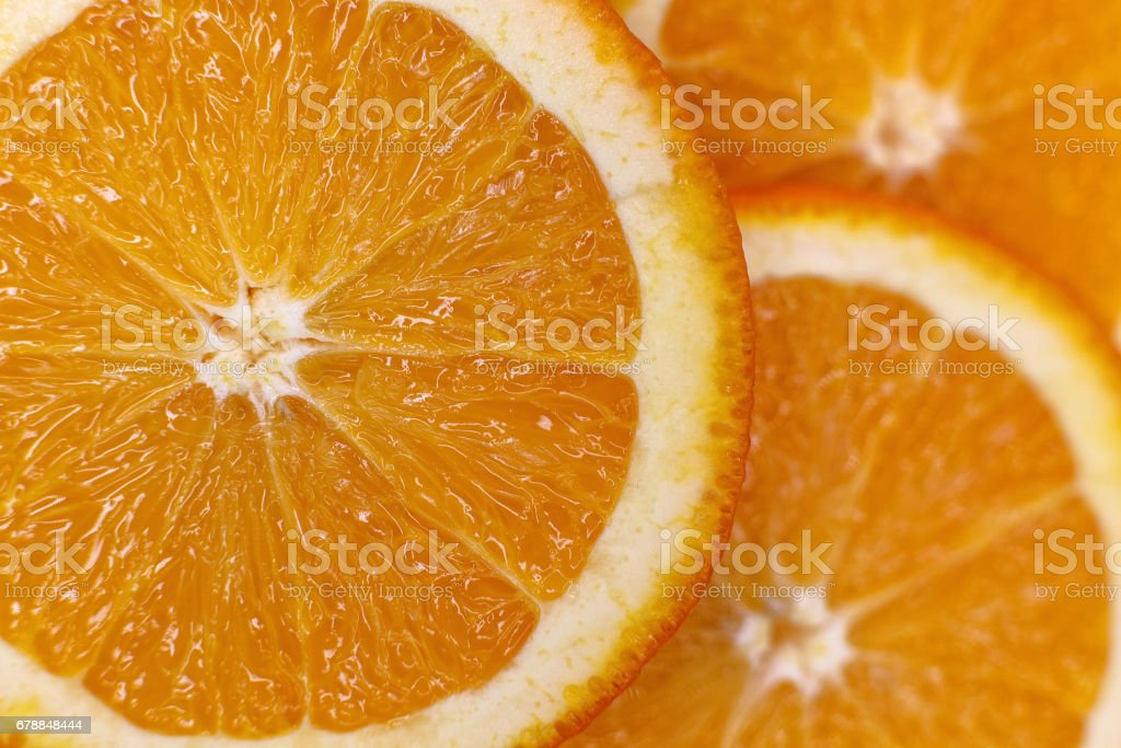 background made with a heap of sliced oranges stock photo