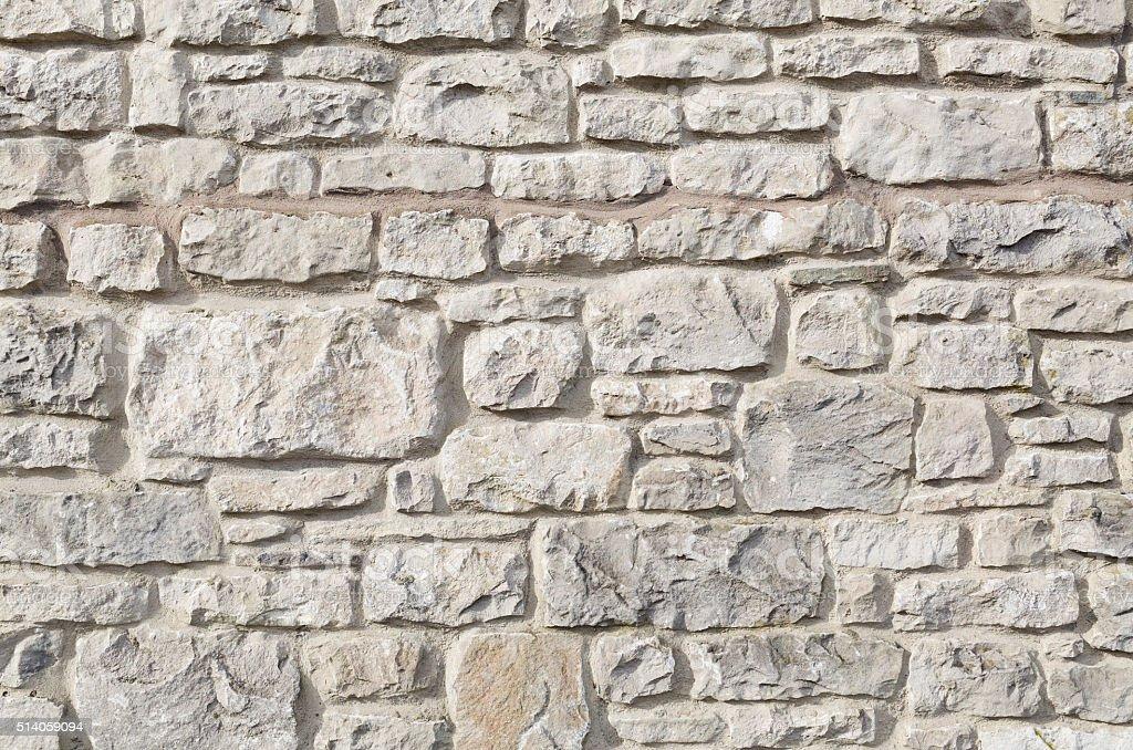 Background: masonry mortar stone wall close-up stock photo