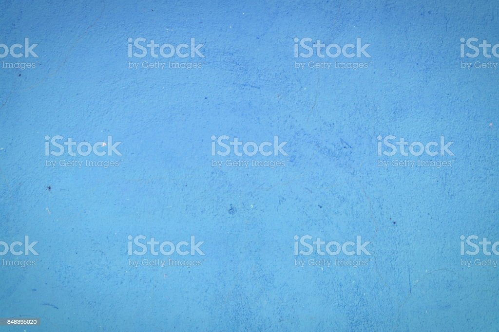 Background of a blue stucco coated and painted exterior, rough cast of cement and concrete wall texture, decorative rustic coating stock photo