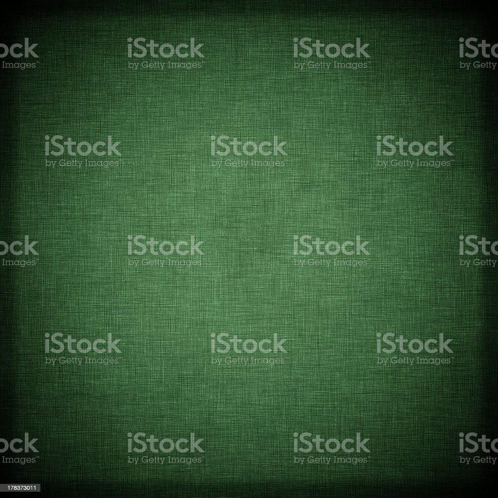 A background of a green textile royalty-free stock photo