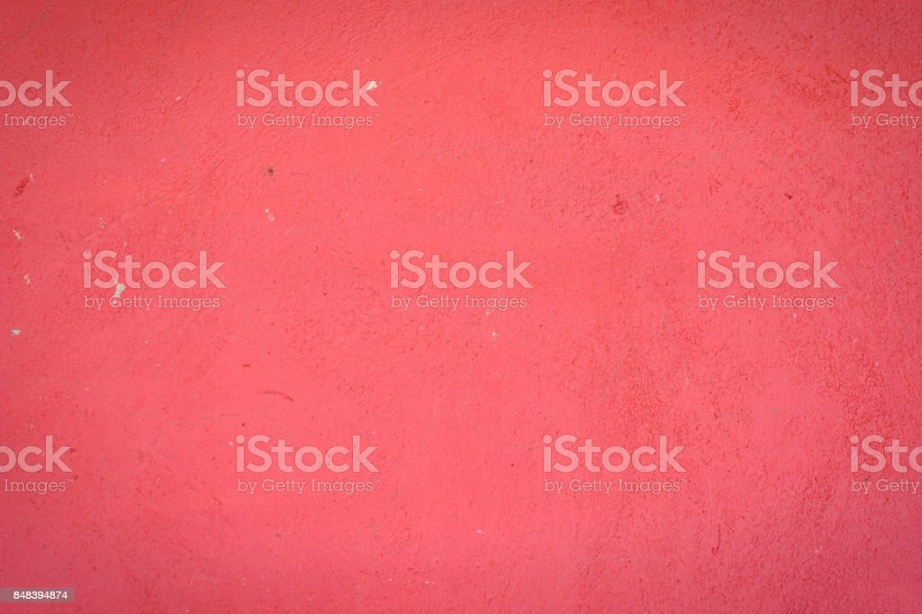 Background of a red stucco coated and painted exterior, rough cast of cement and concrete wall texture, decorative rustic coating stock photo