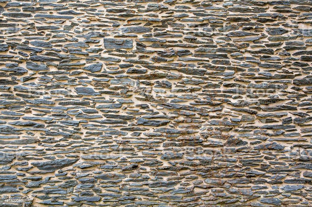 fondo de una pared de piedra exterior uniforme de papel tapiz foto de stock libre de