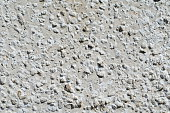 Background of a white stucco coated and painted exterior,