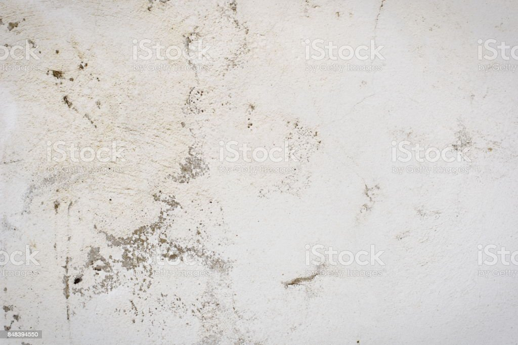 Background of a white stucco coated and painted exterior, rough cast of cement and concrete wall texture, decorative rustic coating stock photo