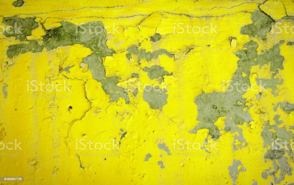 Background of a yellow stucco coated and painted exterior, rough cast of cement and concrete wall texture, decorative rustic coating stock photo