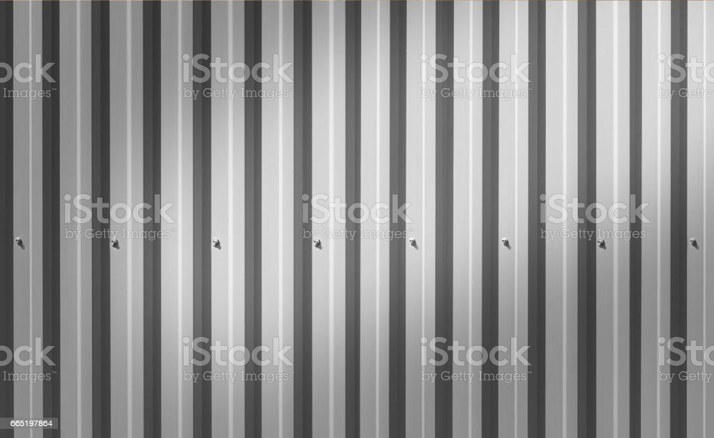 Background of an iron fence with screws stock photo
