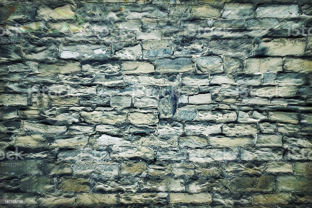 Background of an old exterior stone wall detail - effect royalty-free stock photo