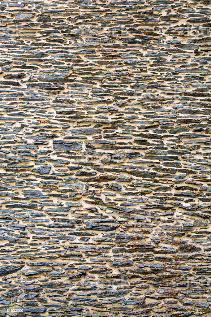 Background of an old exterior stone wall wallpaper vertical stock photo