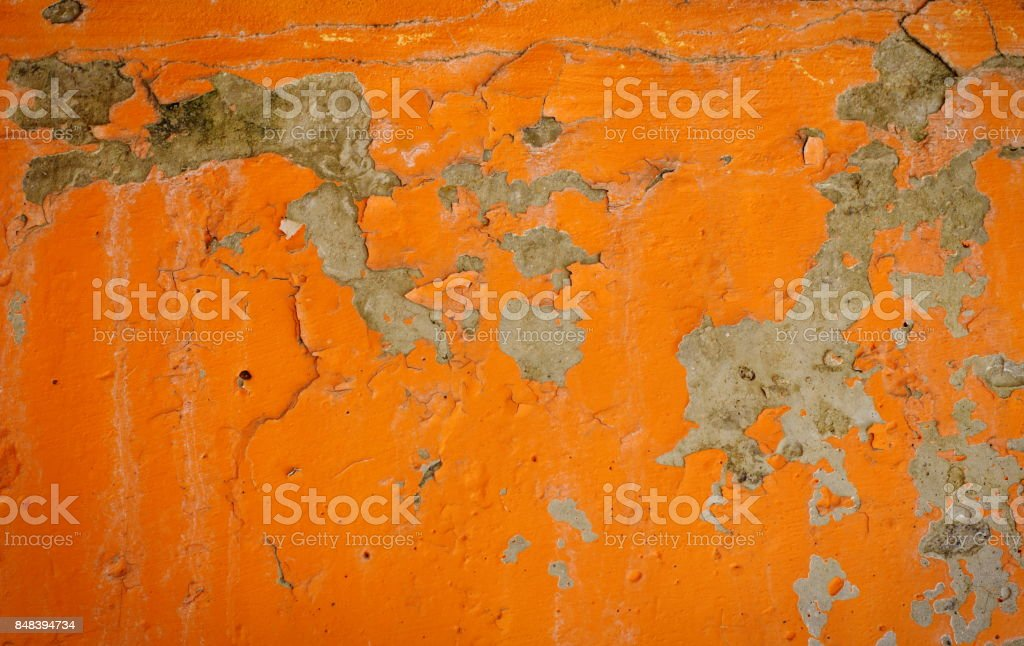 Background of an orange stucco coated and painted exterior, rough cast of cement and concrete wall texture, decorative rustic coating stock photo