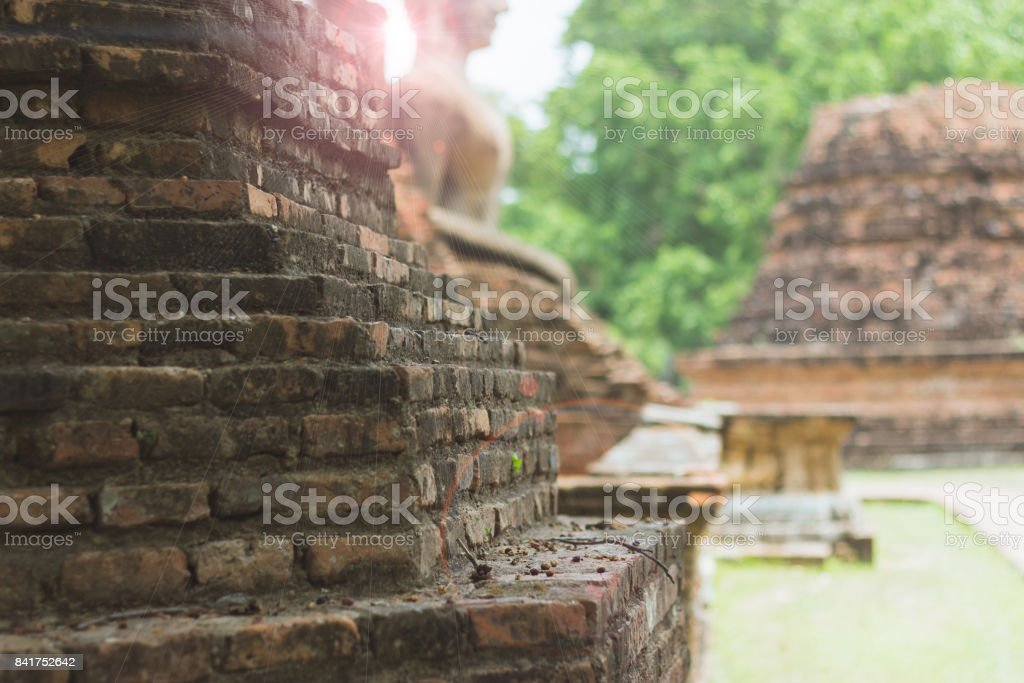 Background of ancient brick wall With Buddha and nature stock photo