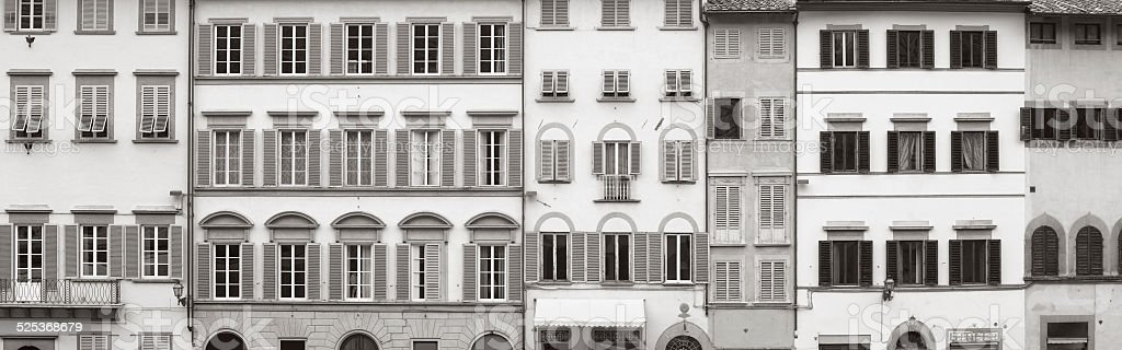 Background of ancient buildings of Florence with many windows stock photo