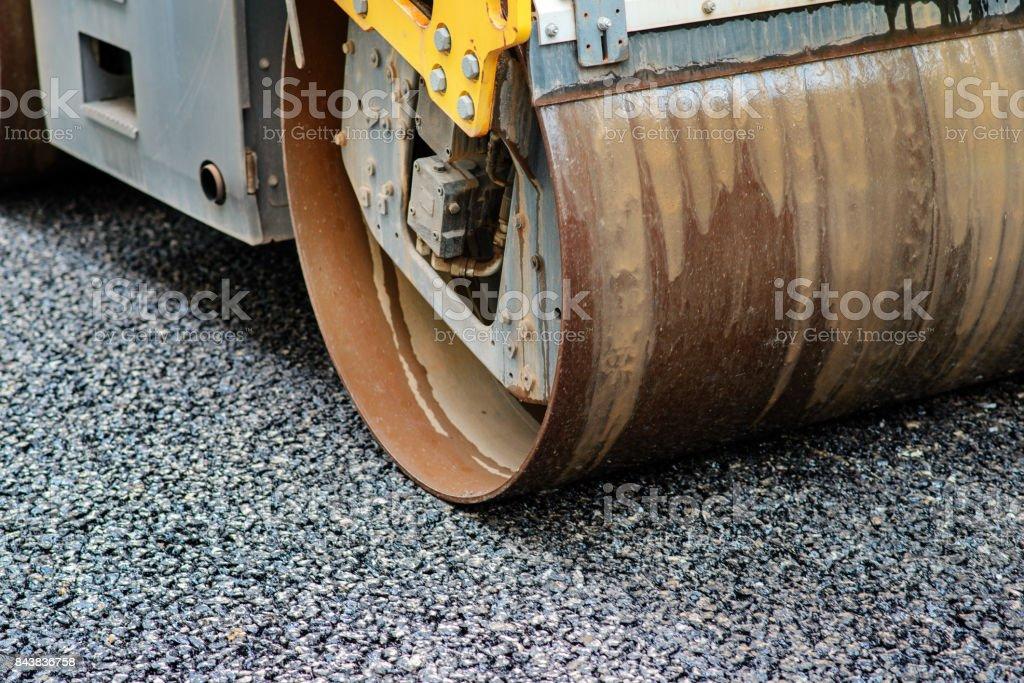 Background of asphalt roller that stack and press hot asphalt. Road repair machine stock photo