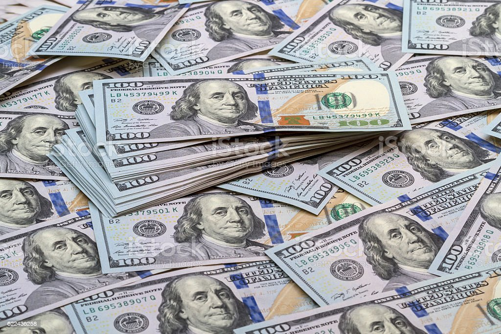 Background of banknotes hundred dollars stock photo