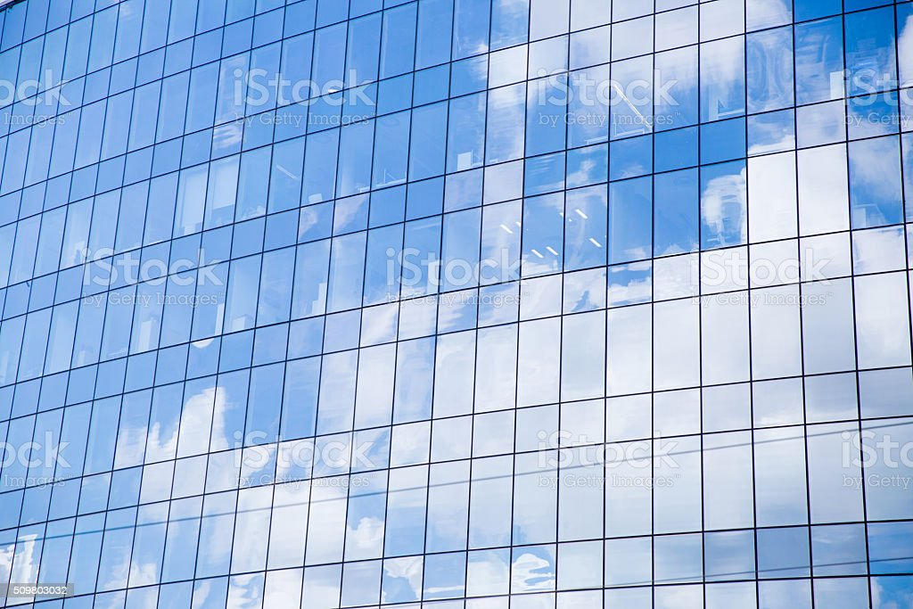 Background of blue sky reflected on the glass wall stock photo