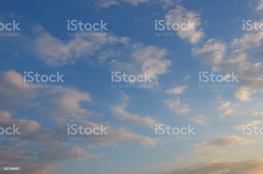 Background of blue sky with fleecy clouds. stock photo