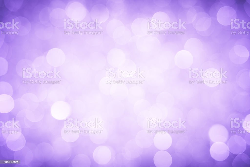 A background of bright purple defocused lights stock photo