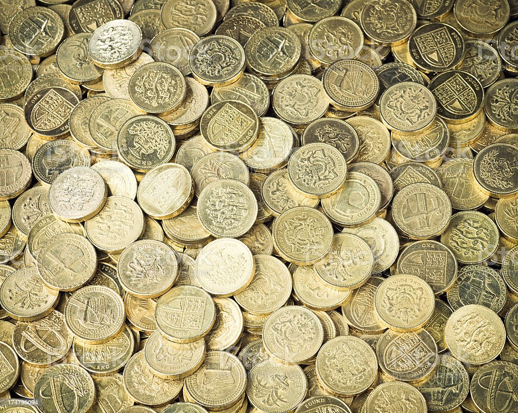 Background of British One Pound Coins stock photo
