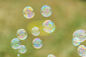 Background of bubbles against green grass