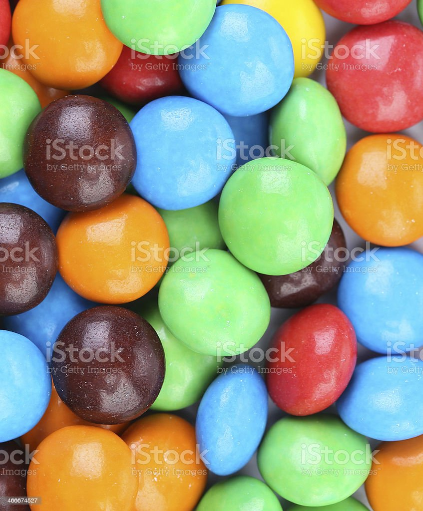 Background of chocolate balls in colorful glaze. stock photo