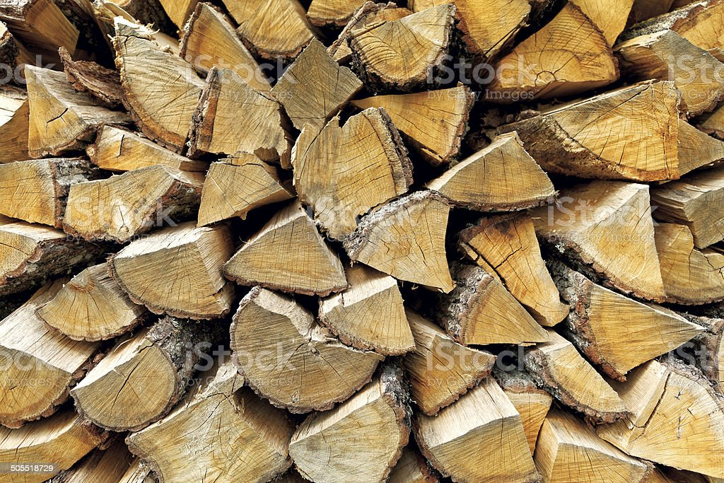 Background of chopped firewood logs royalty-free stock photo