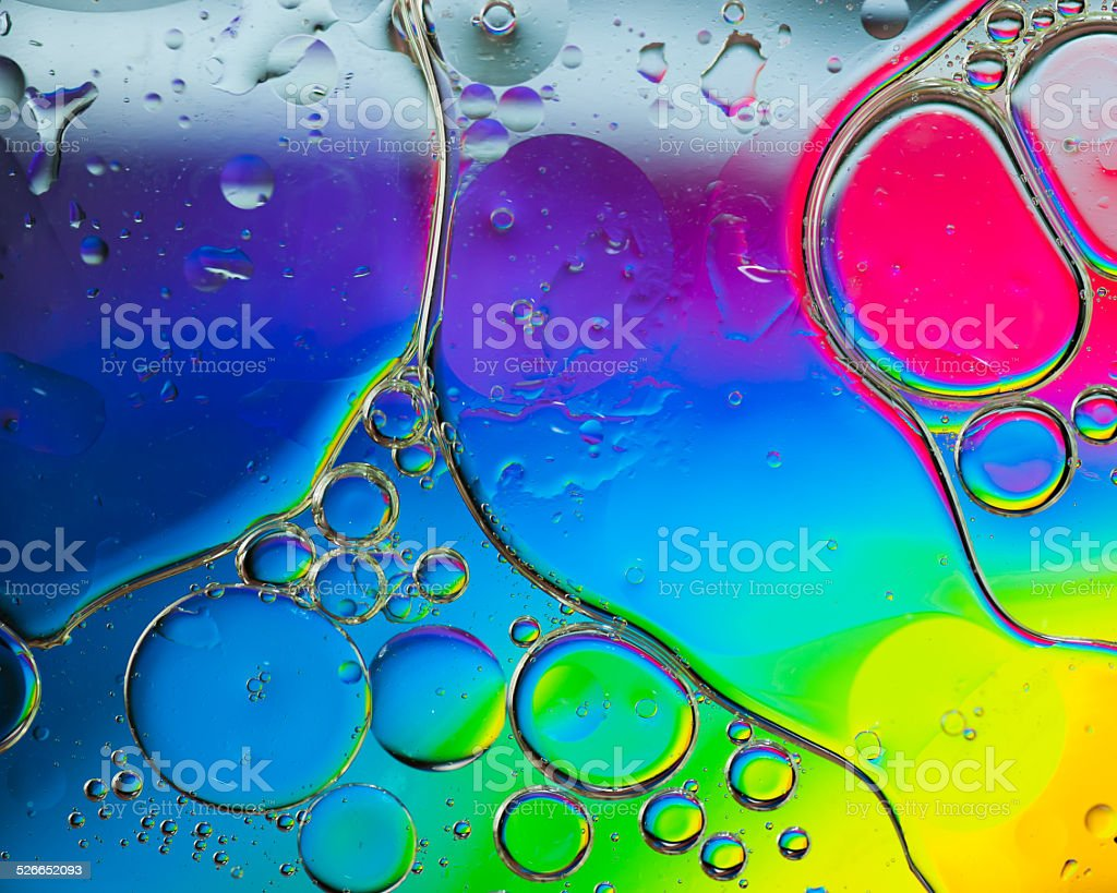 Background of colorful oil drops in water stock photo