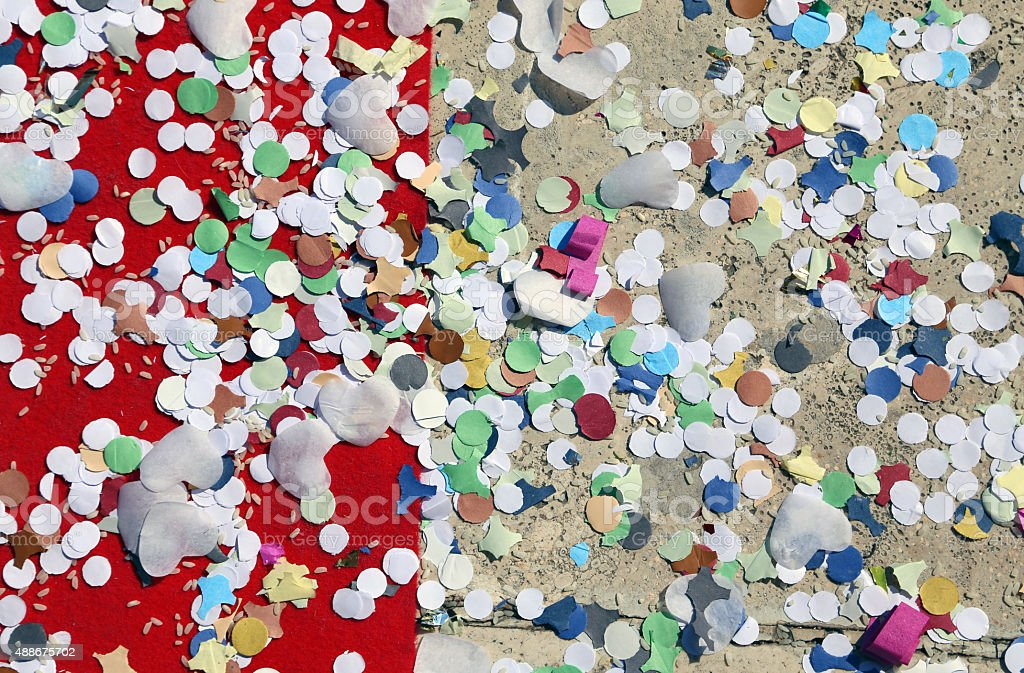 background of confetti and rice in the red carpet stock photo