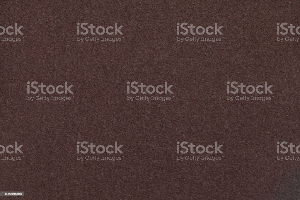 Background of dark brown felt stock photo