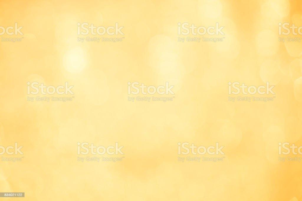 background of defocused abstract lights. golden bokeh lights. stock photo