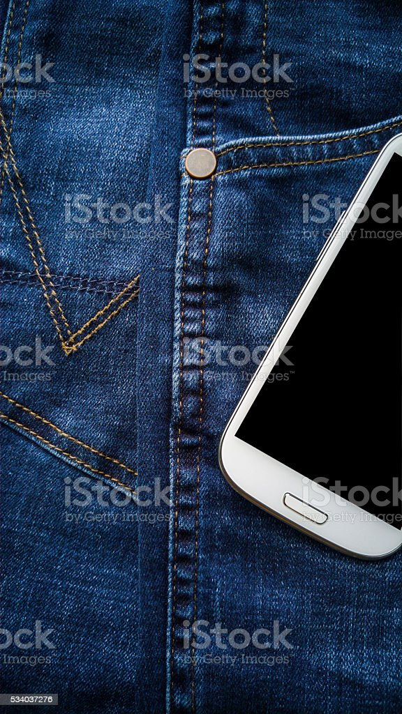 Background of detail blue denim Jeans with pocket smart phone stock photo