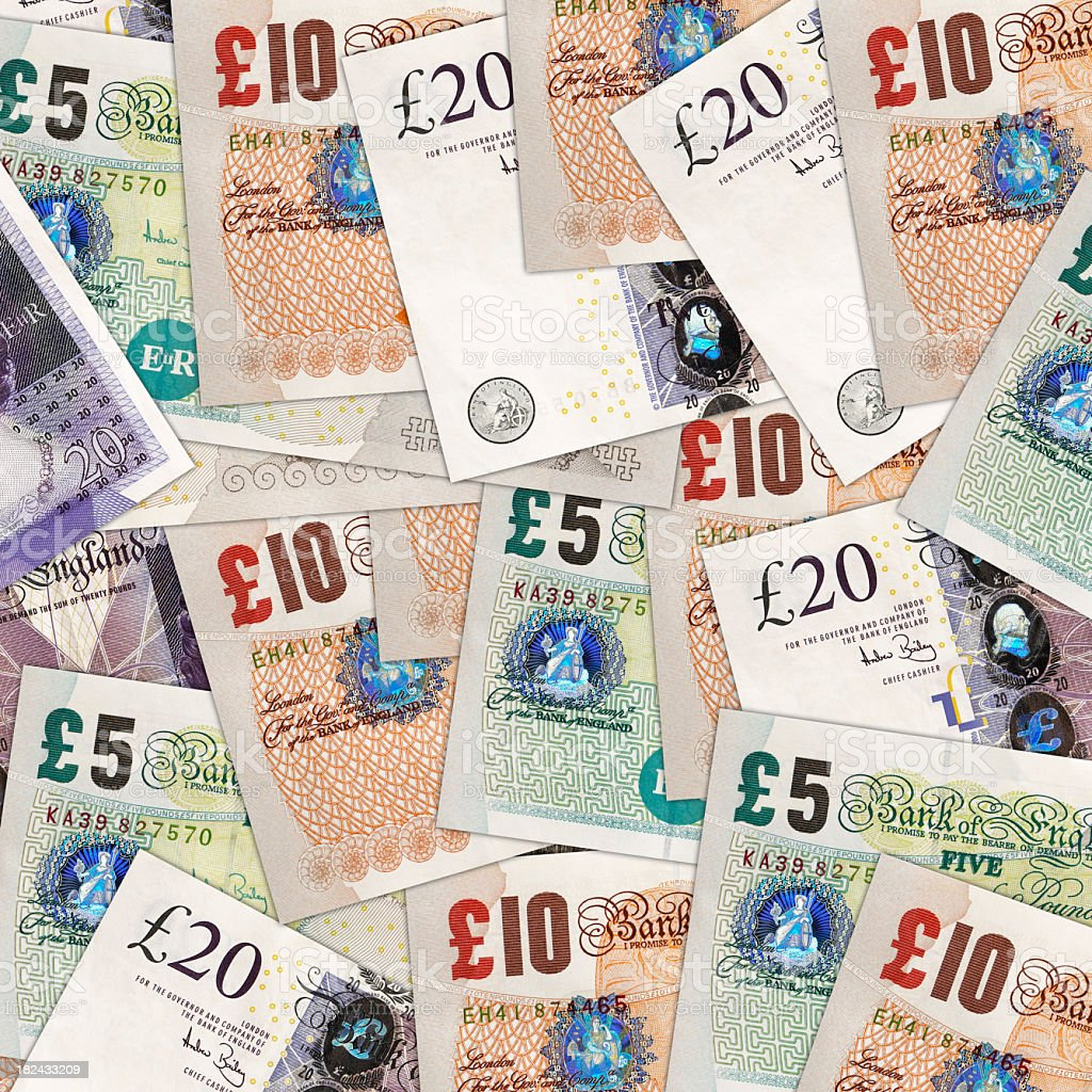 A background of different British pounds royalty-free stock photo