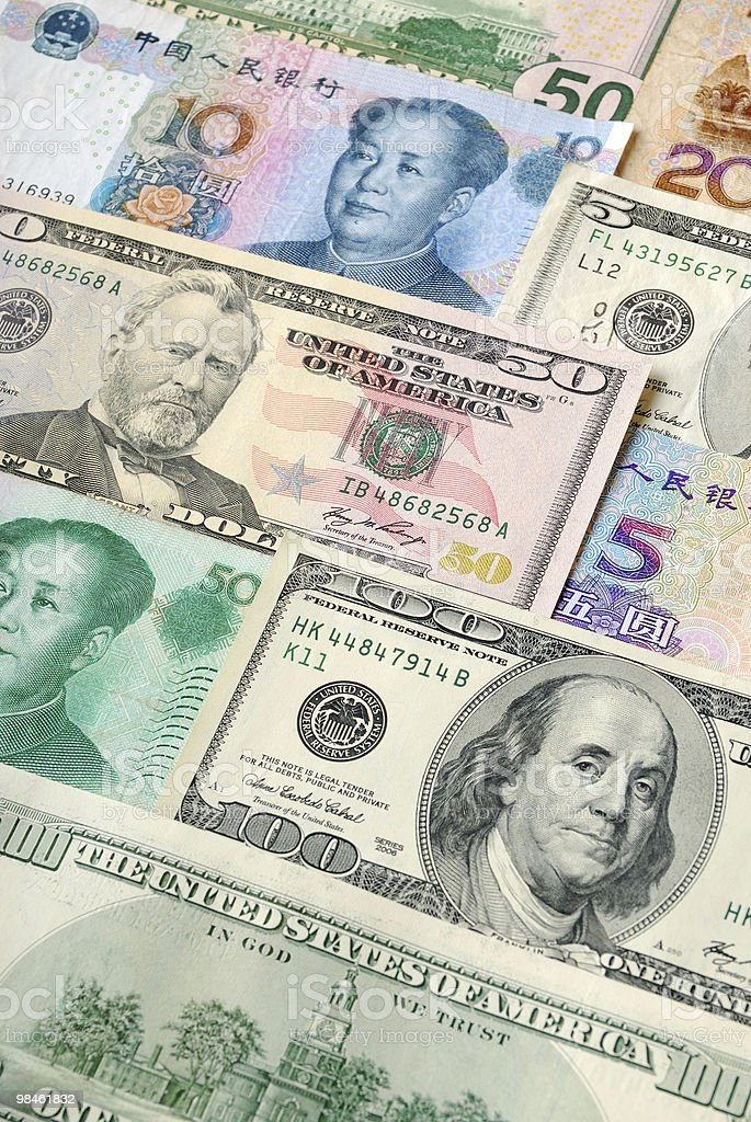 Background of Dollar and Yuan Bills stock photo