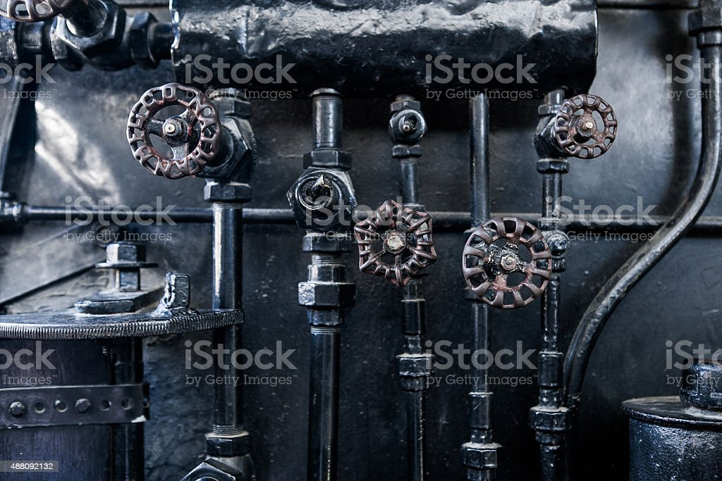 Background of engine room detail in a steam locomotive stock photo
