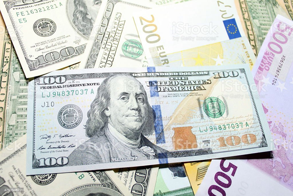 Background of euro and dollar bills. Shallow focus. stock photo