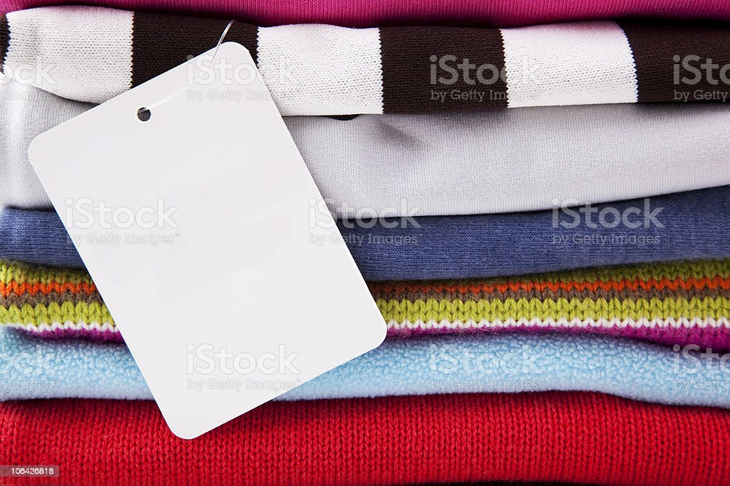 background of folded clothes with blank label royalty-free stock photo