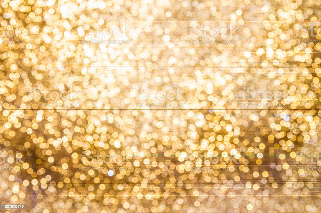 Background of Golden lights with bokeh effect stock photo